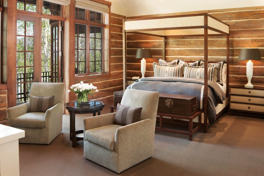A guest suite boasts a large balcony overlooking the mountains.
