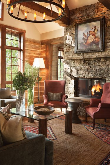A dry-stacked stone fireplace lends a rustic feel in the gathering room.