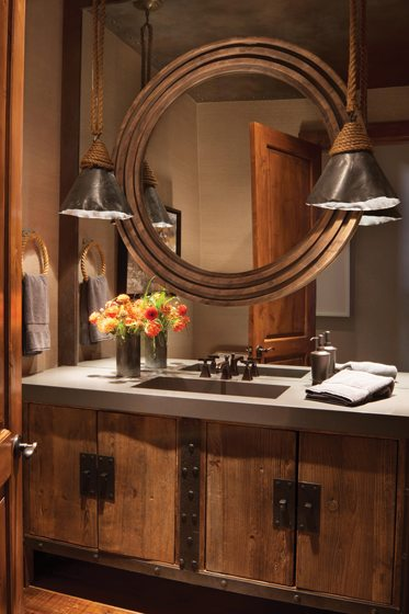 The powder room boasts  hammered-iron pendants.