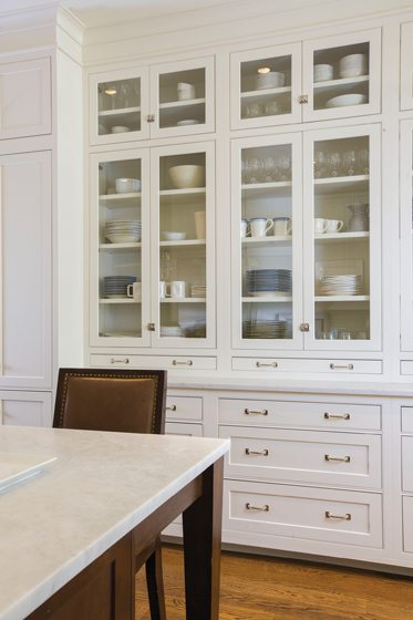Custom Wood-Mode cabinetry was combined with marble countertops.
