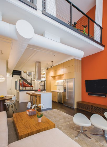 Beyond the kitchen, an awkward elevated area is now a functional study.