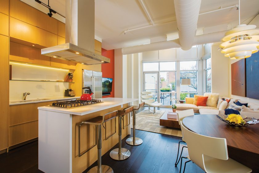 In the kitchen, the island countertop was widened to accommodate stools from Design Within Reach.