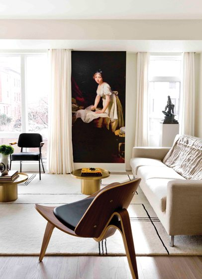 Modern furnishings play off the photo mural of an 18th-century painting.