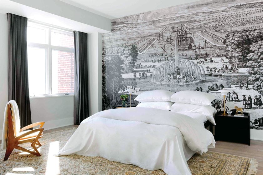 A scene from Versailles covers a wall in the master bedroom.