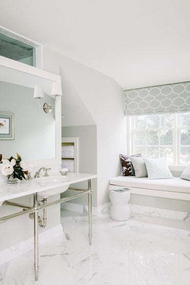 The master bath features Carrara marble floors and fixtures by Waterworks.