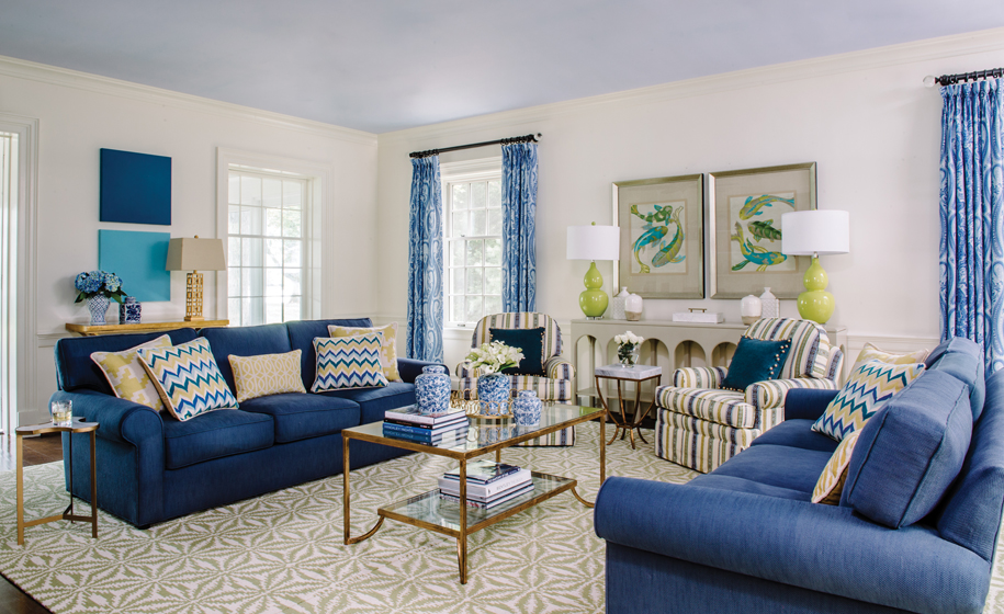 In the living room, two gourd lamps and a pair of custom-screened koi prints add pops of vivid color.