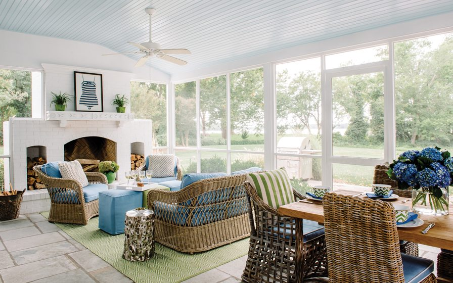 The homeowners added a fireplace to the screened porch for year-round comfort.