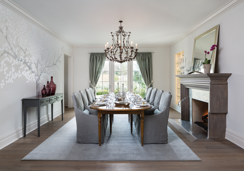 A mural by Rosey Cameron Smith and a hammered-metal fireplace surround enhance the dining room.