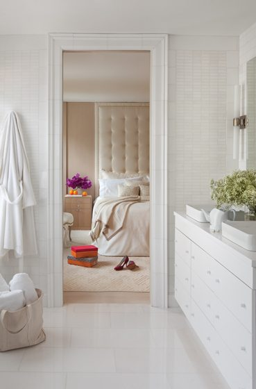 From the luxurious master bath, the cream-hued master bedroom beckons. © Ron Blunt