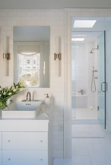 The master bath is clad in Thassos marble tile from Architectural Ceramics. © John Cole