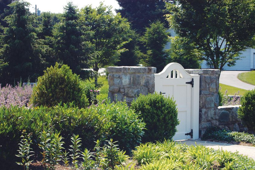 A gate leads to gardens within. © Erin Brooke Bogan and John Spaulding