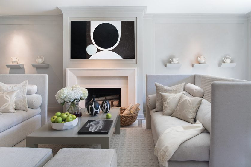 In the gray-toned living room, Drysdale hung graphic art by Julie Wolfe above the fireplace. © John Cole