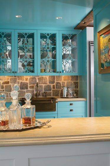 Sandy Brock requested a small bar area near the front door painted bold peacock blue.