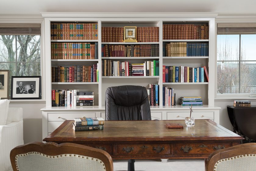 Brock's office contains an antique desk and shelves of rare books.