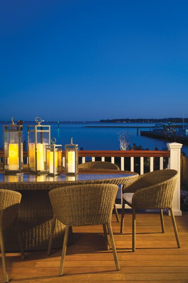 Dining al fresco is easy on the porch, where views of the Chesapeake Bay beckon.