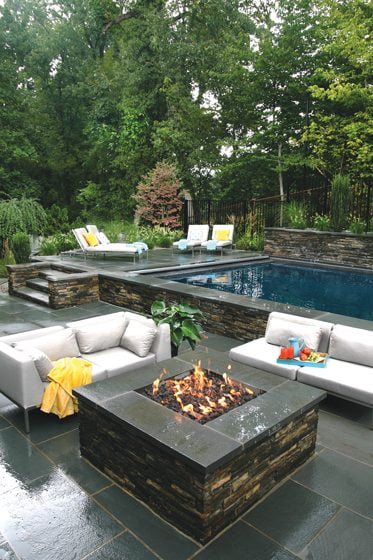 A fire pit sits beside the pool. © Jennifer Heinz Zahner and Mark Voelkel