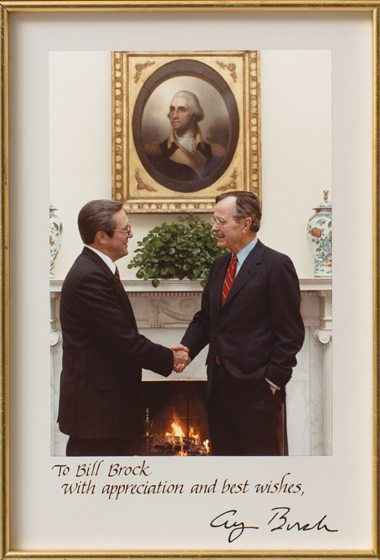 A photo of Brock meeting with George H.W. Bush.