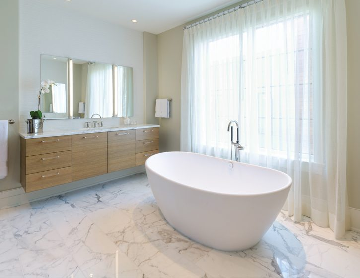 The master bath boasts a sculptural soaking tub.
