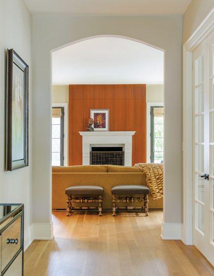 The family room now boasts a mahogany fireplace wall.