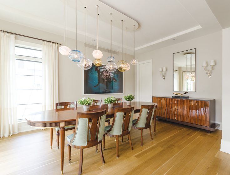 In the dining room, a photo of a swimming dog by Seth Casteel overlooks the restored table.