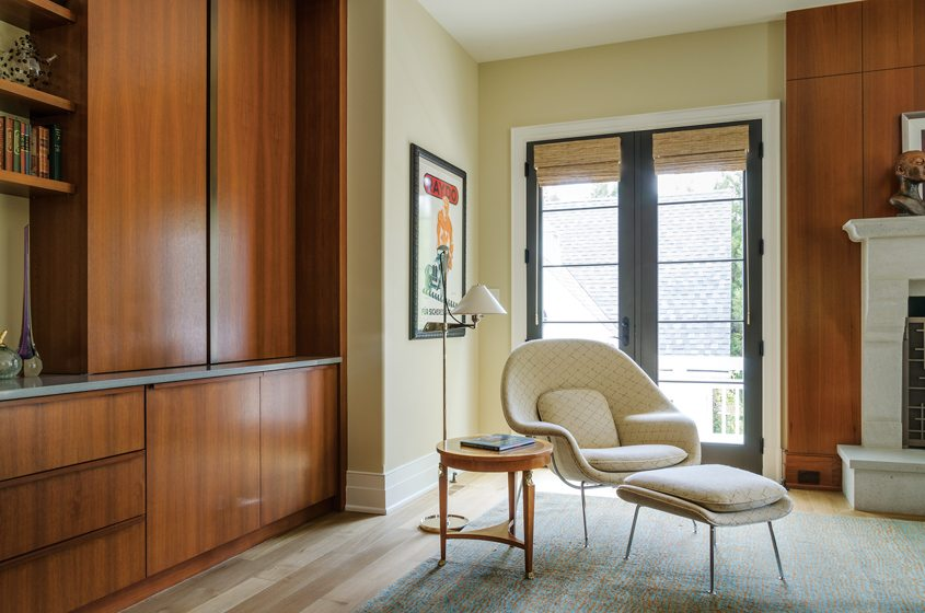 A Womb chair adds a modern touch in the finished family room.