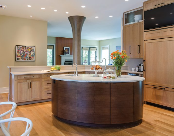 A distinctive oval island occupies center stage in the kitchen.