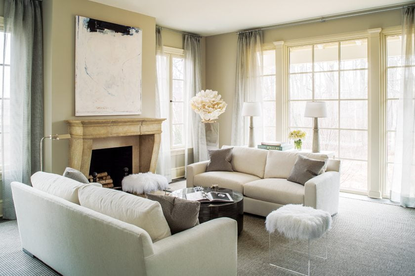 The living room's soft neutrals are deceptively practical, with acrylic fabric and a polypropylene rug.