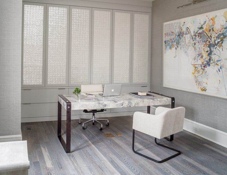 Mother-of-pearl Maya Romanoff tiles add shimmer to the study's cabinet doors.
