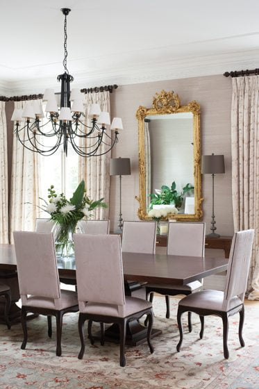 An antique mirror from Spain hangs in the formal dining room.