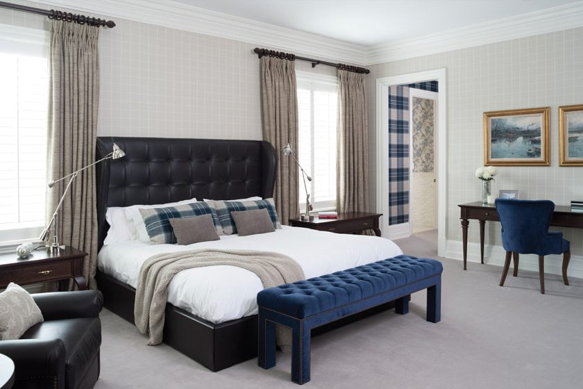 A masculine vibe prevails in the master suite.