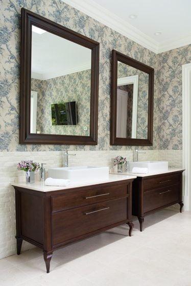 Sinks and plumbing fixtures from Porcelanosa top custom vanities.