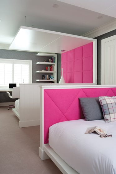 Beds with tufted-fabric panels give each girl her own space.