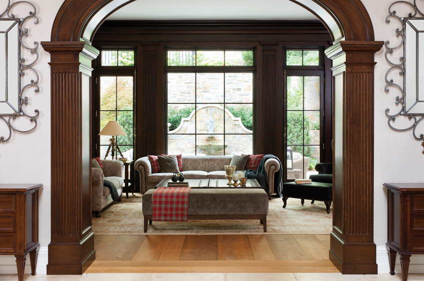 A mahogany archway leads from the foyer to the family room.