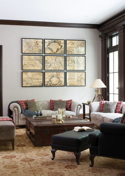 In the family room, an antique Persian rug grounds custom sofas and an ottoman.