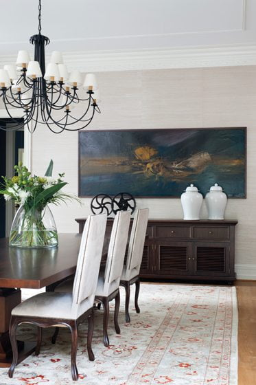 The dining room is graced by a painting by Spanish artist Manuel Viola.