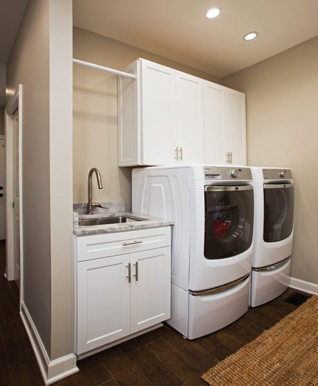 The laundry room occupies a niche in the mudroom.
