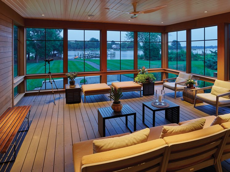 A screened porch was built on raised concrete piers to meet flood-zone requirements. © Alan Karchmer