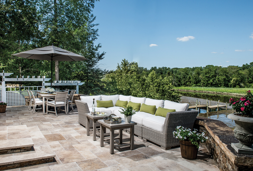 From the spacious terrace, pathways wind down to the dock.