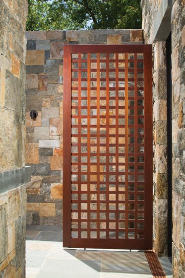 A trellis door leads to an outdoor shower.
