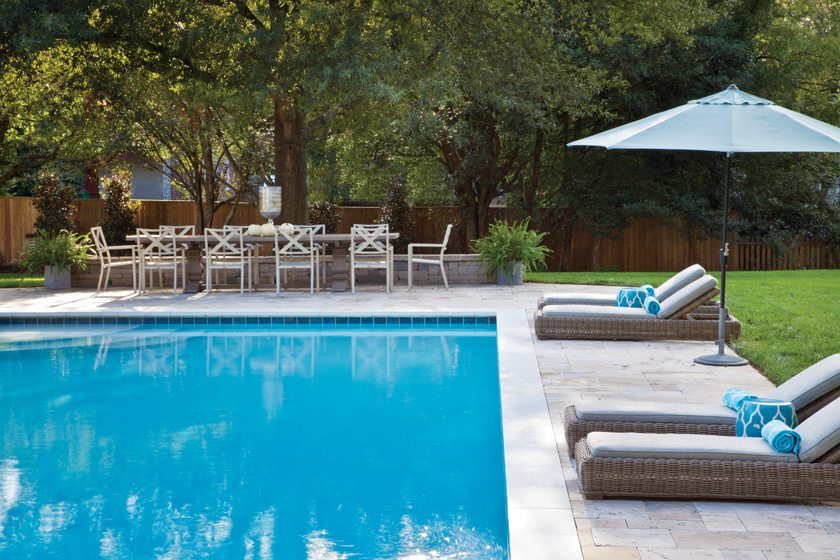 In the spacious backyard, the swimming pool beckons.