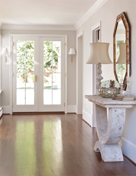 The French doors open to the foyer, which holds a hall table from the Phillips Collection.