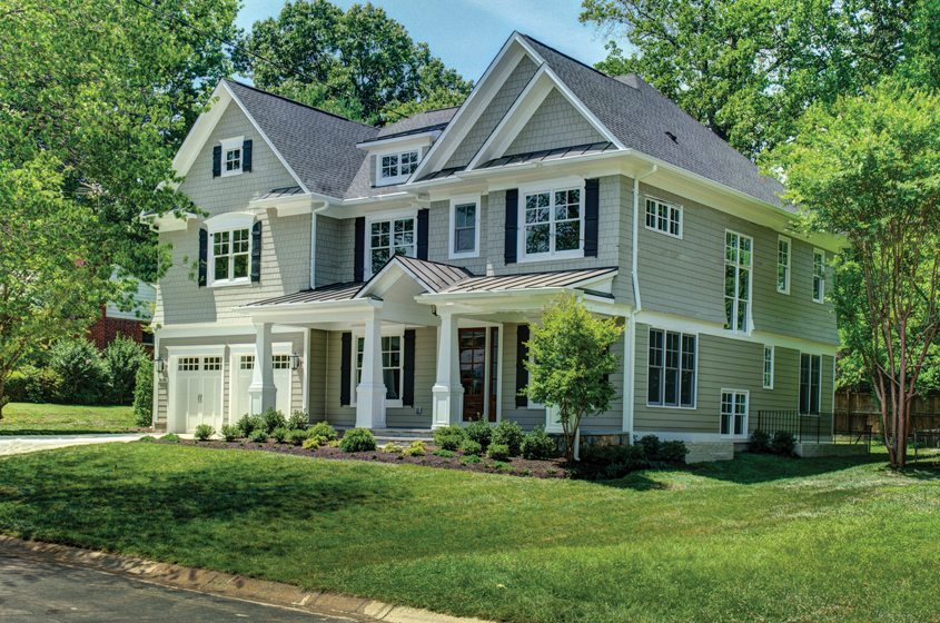 A spec home by Three Brothers Land Co. offers a traditional welcome.