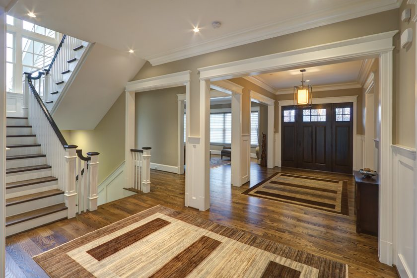 A traditional home by Studio Z Design Concepts boasts an open-plan foyer.