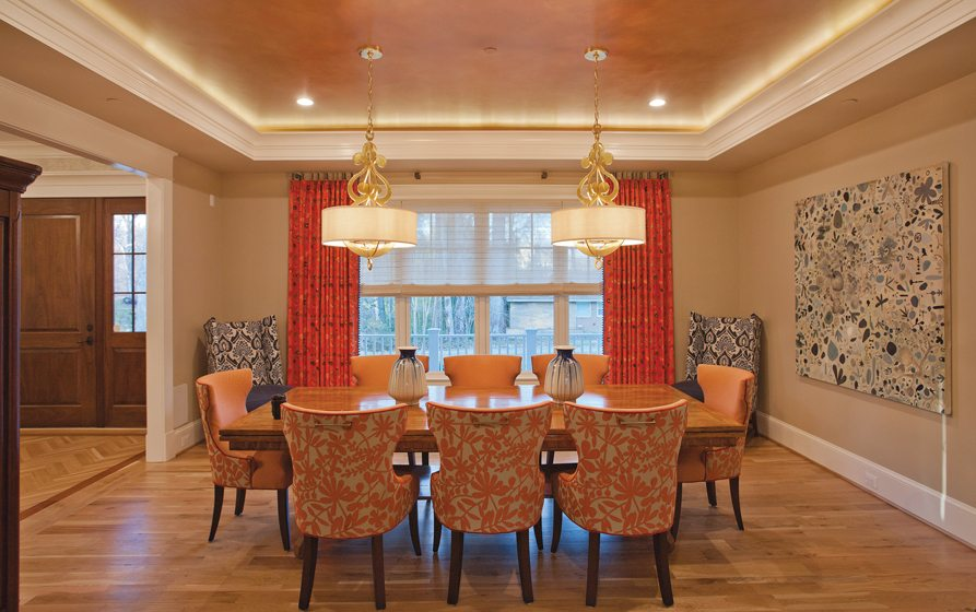 A colorful dining room pops in a home by Laurence Cafritz Builders.