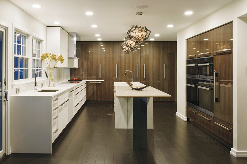 Paul Bentham designed a dual-level island with a table-like extension in a bold kitchen makeover in Columbia, Maryland.