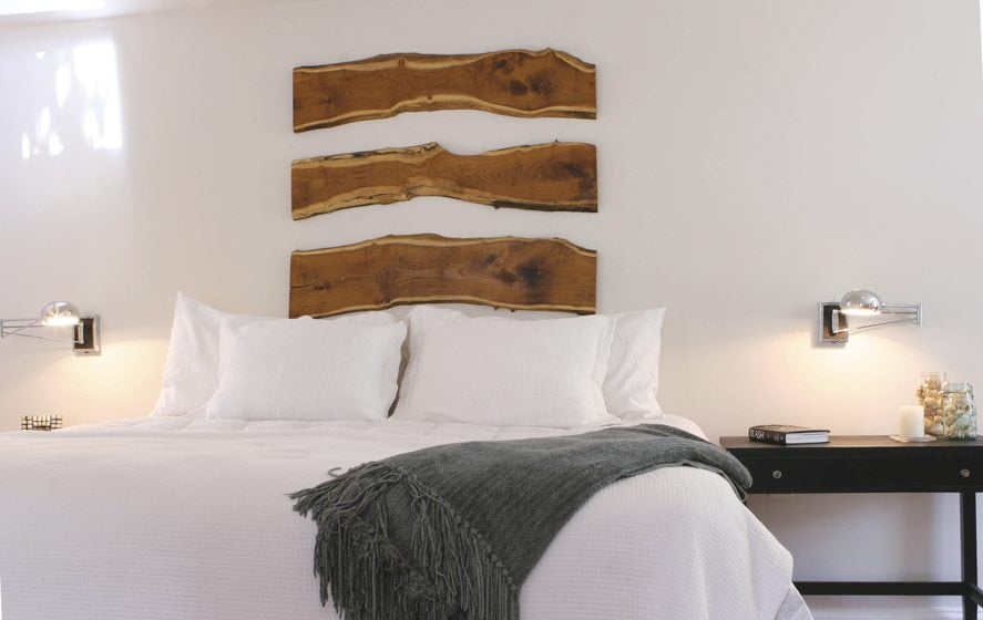 Riggio embellished her own bedroom with planks of exotic wood that act as a headboard. © Edward Underwood