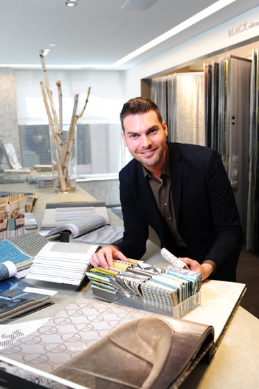 Kenneth Byrd reviews fabric samples in the Romo showroom. © Michael Ventura