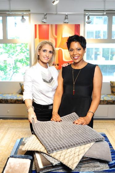 Erica Riggio (left) and Angela Justice peruse rug samples in the Doris Leslie Blau showroom. © Michael Ventura