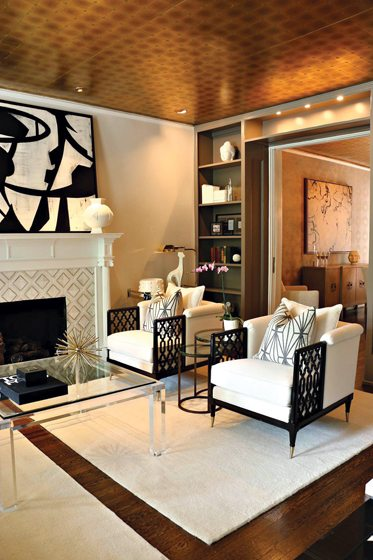 He revived a living room with a reflective Phillip Jeffries wall covering on the ceiling.