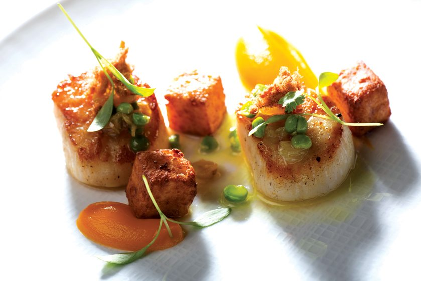 Magdalena's seared scallops with pork fritter and English peas in a truffle-honey-mustard sauce.
